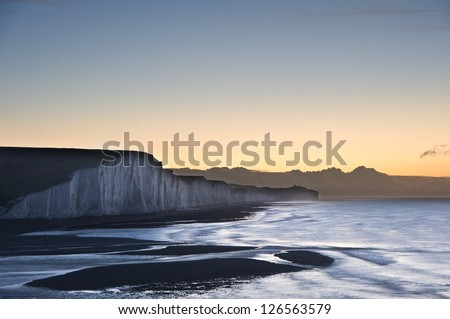 Seven Sisters chalk cliffs in England during Winter sunrise - stock photo