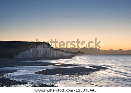 Seven Sisters chalk cliffs in England during Winter sunrise landscape - stock photo