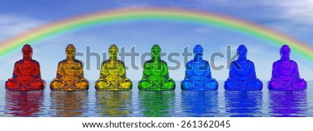 Seven small buddhas in chakra colors meditating under rainbow and upon water by day - 3D render - stock photo