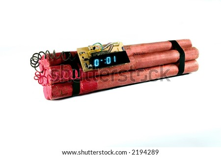 Seven sticks of dynamite with a timer set that has 1 second remaining