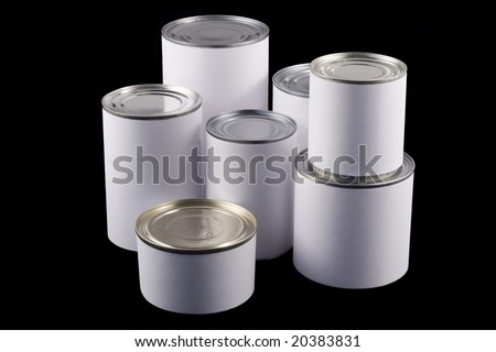 Seven tin cans of different sizes with white labels