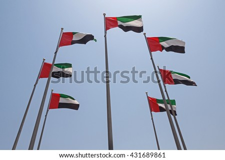 seven United Arab Emirates flags over blue sky