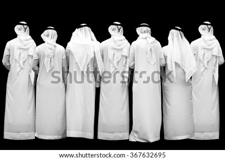 seven unknown arab persons, b/w - stock photo
