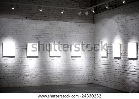 Seven white empty frames on exposition - stock photo