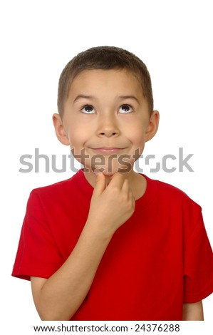 Seven-year-old boy looking up thinking - stock photo