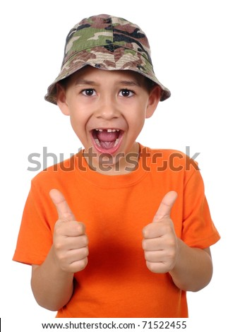seven year old boy missing tooth giving thumbs up sign, isolated on pure white background - stock photo