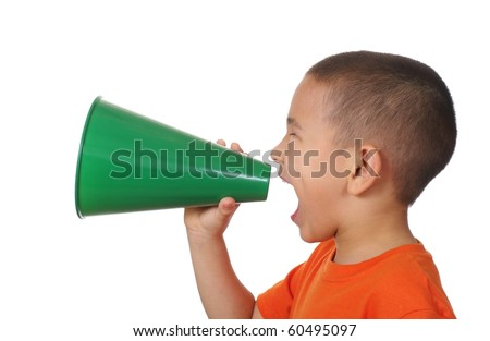 seven year old boy shouting through a green megaphone, isolated on a pure white background