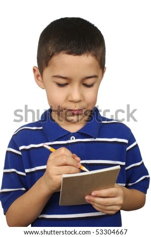 Seven-year-old boy writing on a notepad, isolated