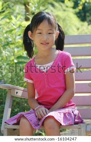 seven-year-old girl sit on chair