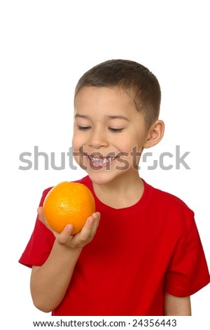 Seven-year-old with an orange - stock photo