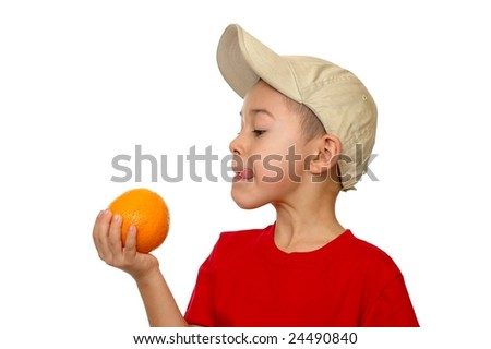 Seven-year-old with an orange, isolated on white - stock photo