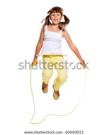 Seven years Girl jumping with skipping rope isolated on white - stock photo