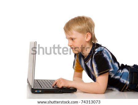 sevenn years Boy Surfing the net isolated on white - stock photo