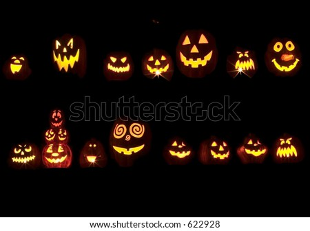 Seventeen Spooky Halloween Jack O Lanterns Glowing In the Dark - stock photo