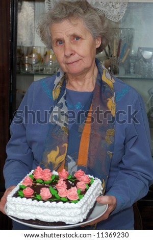 seventy year old woman hold cake