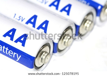 Several AA batteries - stock photo
