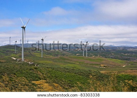 Several aeolian windmills on the top of Meadas of sierra, Portugal - stock photo