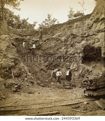 Several African American men working on hillside at the iron ore bank at Elizabeth Furnace in Virginia, 1878. Photo by Jedediah Hotchkiss. - stock photo