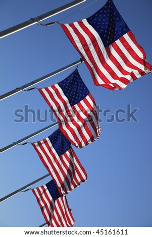 Several American flags in the breeze.