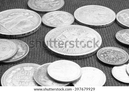 Several ancient silver coins close-up, black and white photo - stock photo