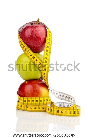 several apples with a tape measure. photo icon for diet and healthy, vitamin-rich diet.