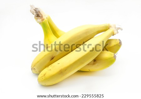 Several bananas from the Canary Islands on white background - stock photo