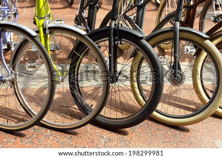 Several bicycle wheels - stock photo