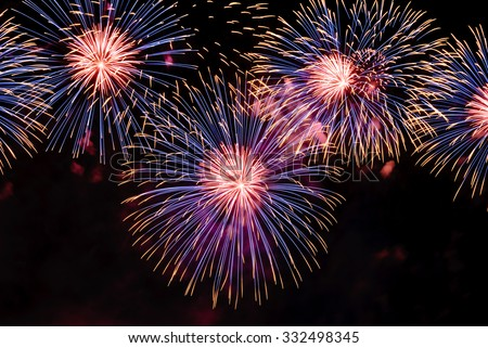 several big fireworks contain yellow, purple and red colors