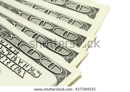 several bills of one hundred dollars on a white background - stock photo