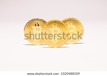 Several Bitcoins on white background