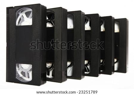 several black VHS video cassettes on white background - stock photo