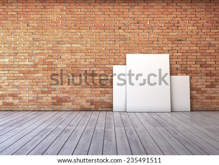 several blank picture in the empty room with red brick wall and wooden floor  - stock photo