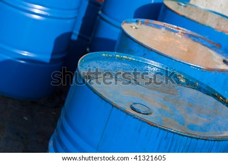 several blue barrels of oil (1) - stock photo