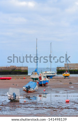Several boats at low tide resting on their keel - stock photo