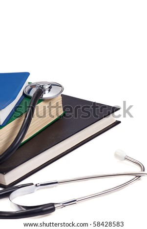 several books and black stethoscope - stock photo