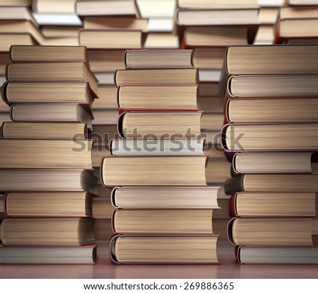 Several books stacked on the table. - stock photo