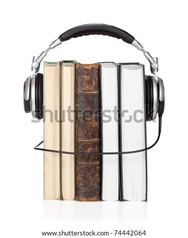 Several books with headphones. Isolated on white background.