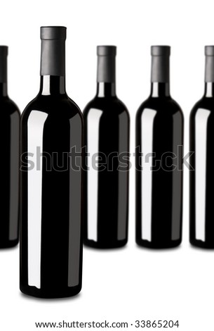 Several bottles of red wine: one standing out of the rest. Shallow DOF. - stock photo