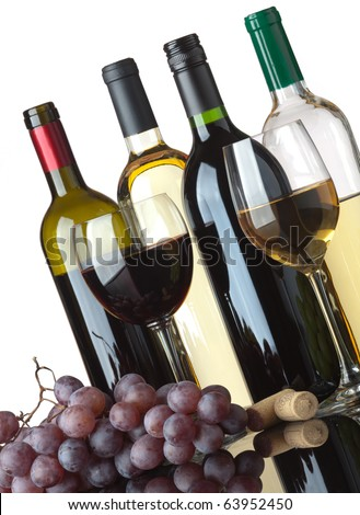 Several bottles of white and red wine, two glasses and grapes isolated on white background - stock photo