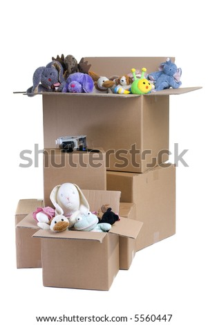 Several boxes full of stuffed animals. Packing up a childs room. - stock photo