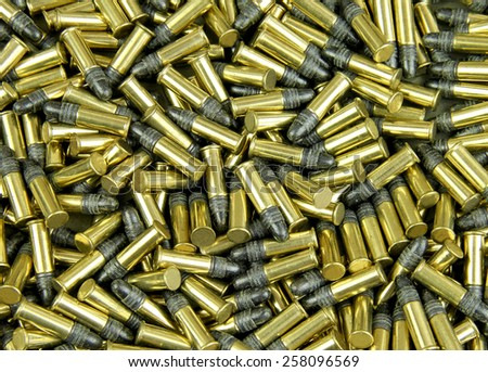 Several Brass cased bullets make a bullet background - stock photo