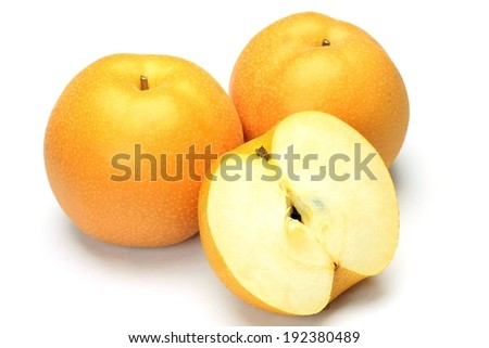 Several bright colored apples, one of them cut in half. - stock photo