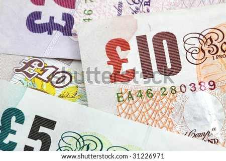 Several british banknotes as a money background - stock photo