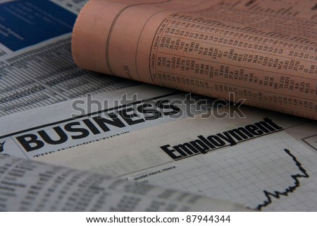 Several business newspapers  are one on one - stock photo