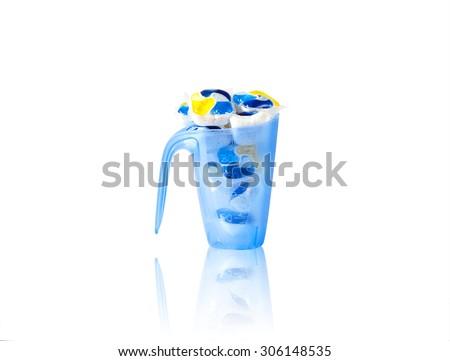 several capsules dishwasher soap isolated on white background with reflection - stock photo