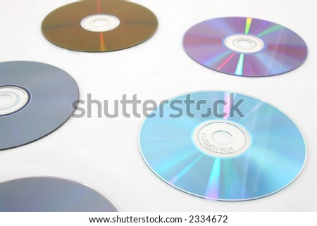 several cd's isolated over white with light reflections