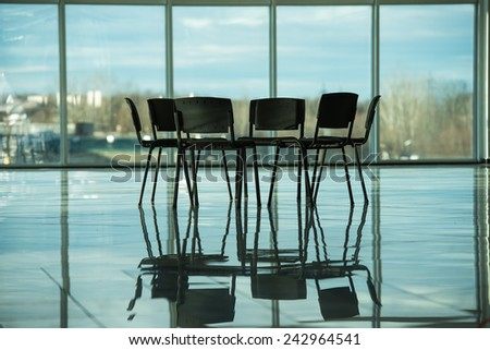Several chairs stand in a circle on the background panoramic windows. The meeting place for support groups.