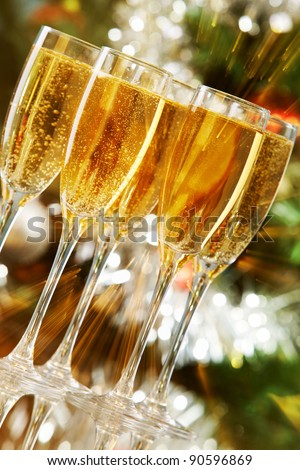 Several champagne flutes on Christmas background - stock photo