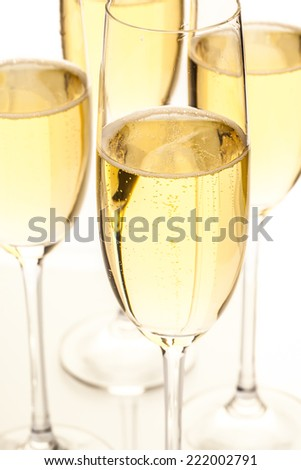 Several champagne glasses next to each other - stock photo