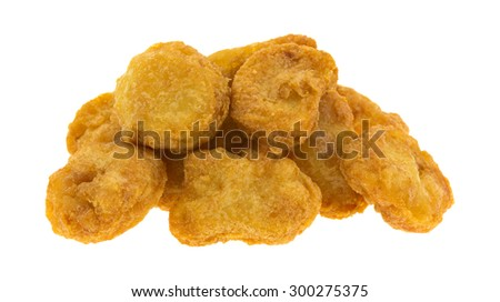 Several chicken nuggets in a small pile isolated on a white background.